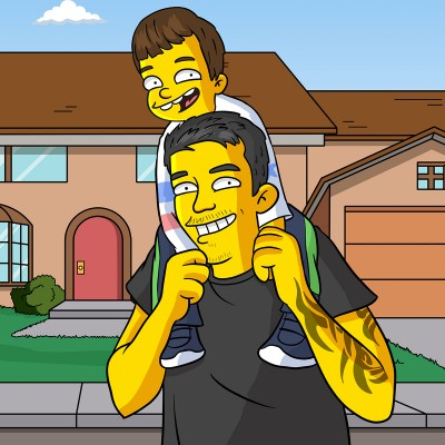 Dad and son as Simpsons characters in front of the Simpsons house.
